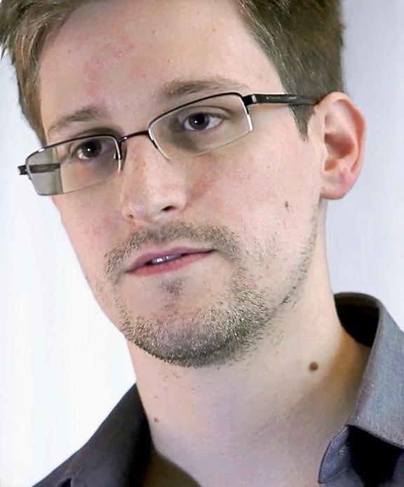 "Edward Snowden's Wikipedia Entry; ""Still at large."""